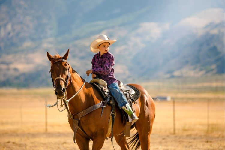 Dude ranch kid on horse-Multigenerational Vacations