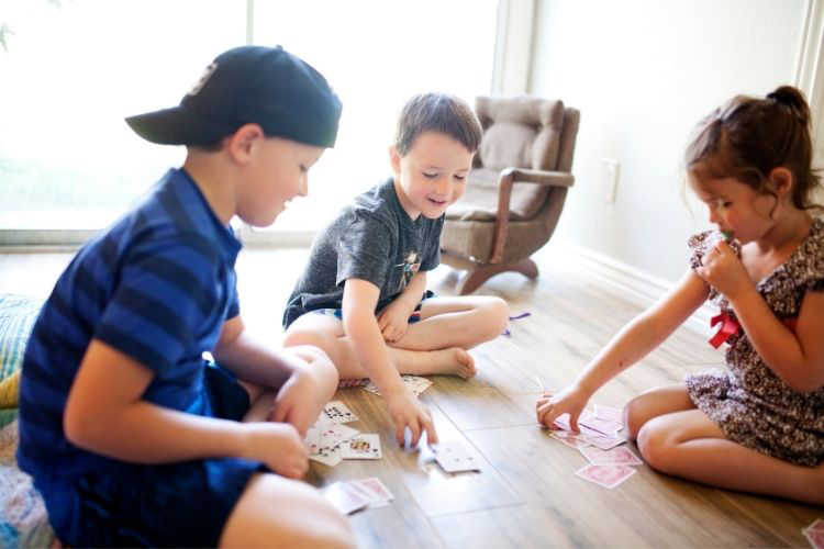 Kids playing cards on vacation-Multigenerational Vacation