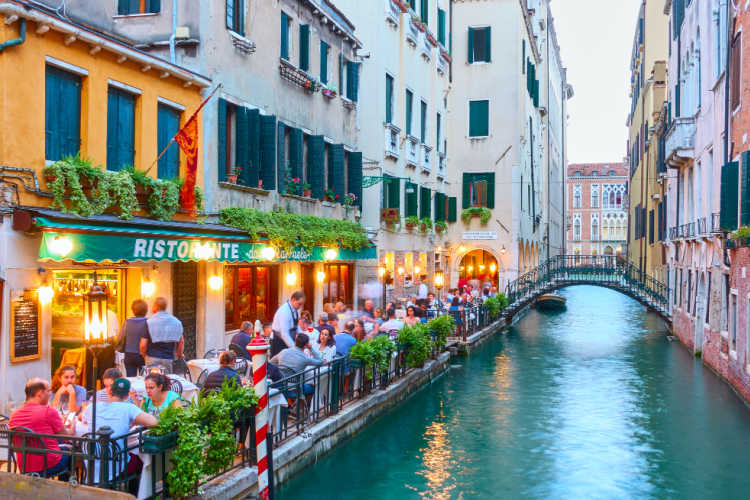 Italy with family restaurant canal Venice